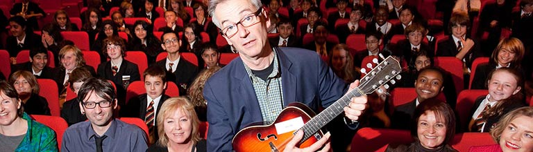 John Hegley with school groups in the Cosmo Rodewald Concert Hall